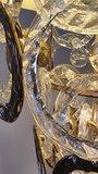hanglamp met glazen en gouden schakelringen in een gouden frame  in een lampenkap van Lumiere sjiek eigentijds  (8)