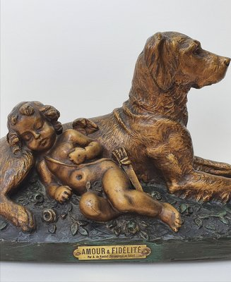 Exclusief antiek beeld Cupido met hond