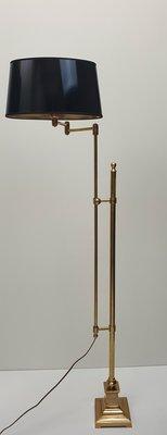 vloerlamp messing met dubbele stang in hoogte verstelbaar en zwenkarm incl. zwarte lak kap ovaal van vorm